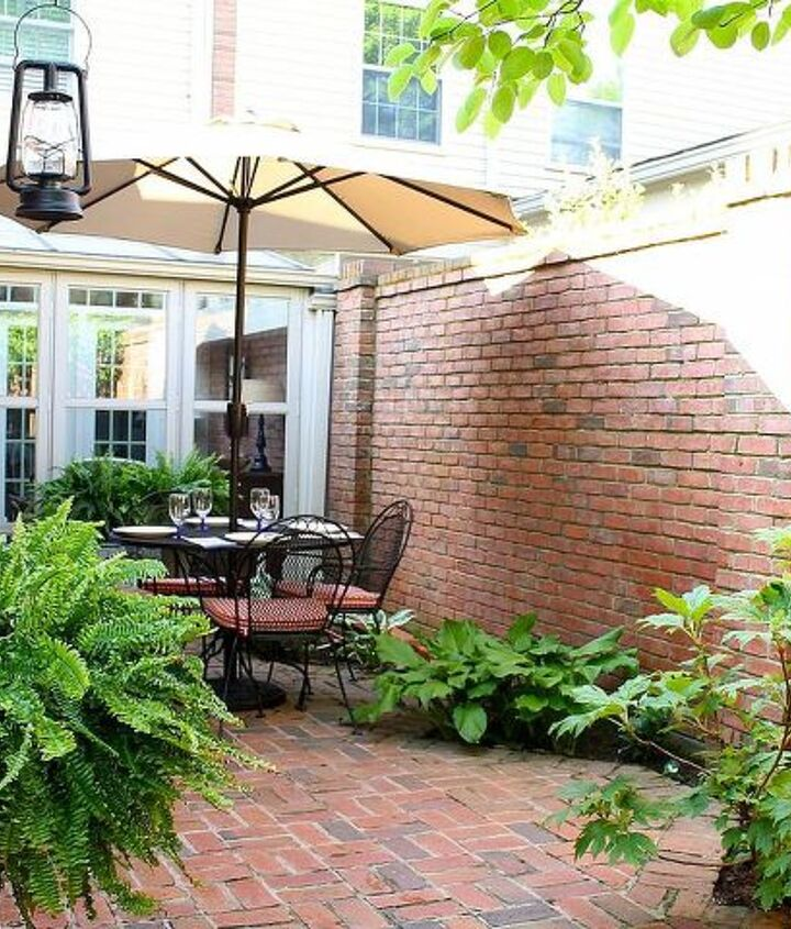 We added ferns, roses, annuals, and vines that will grow and soften the look of the brick.  That makes the area seem more intimate and inviting.