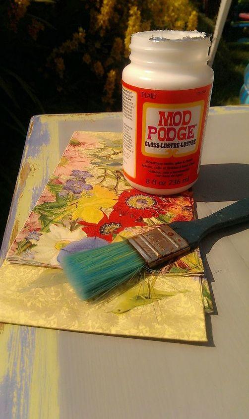 mod podge napkins onto the table top....
