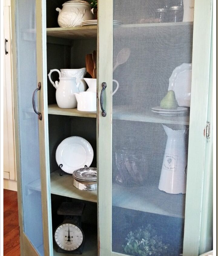 The screened doors really give this old piece a new, fresh look.