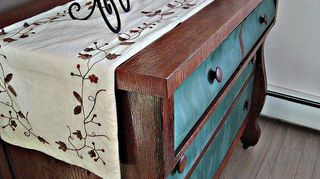 q bought an antique dresser this weekend trying to figure out what chalk paint color, chalk paint, painted furniture, A side view of my transformed dresser with a table runner on top I just love a dresser that is a mix of hand painted surface and varnished wood