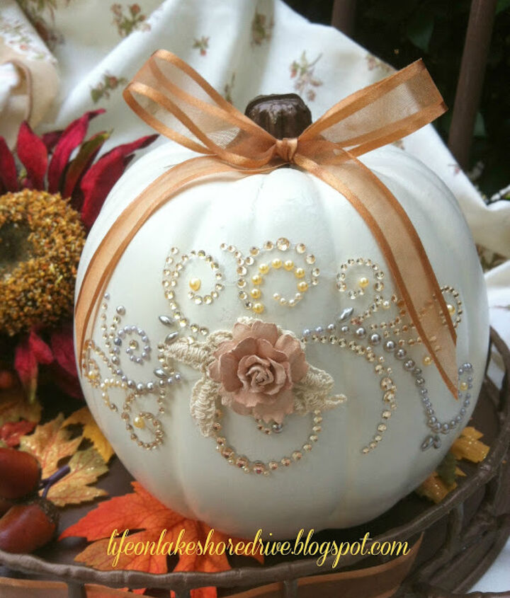I added a scrapbooking decal that I purchased from Hobby Lobby.  It was super easy to use, but takes patience to very slowly peel the decal from the backing.  The decal remained in one piece, and I  carefully applied it to the pumpkin.
