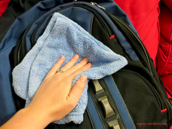 Wipe down the inside and outside of non washer friendly backpacks with a cool soapy water. Wipe down again with plain water to rinse.
