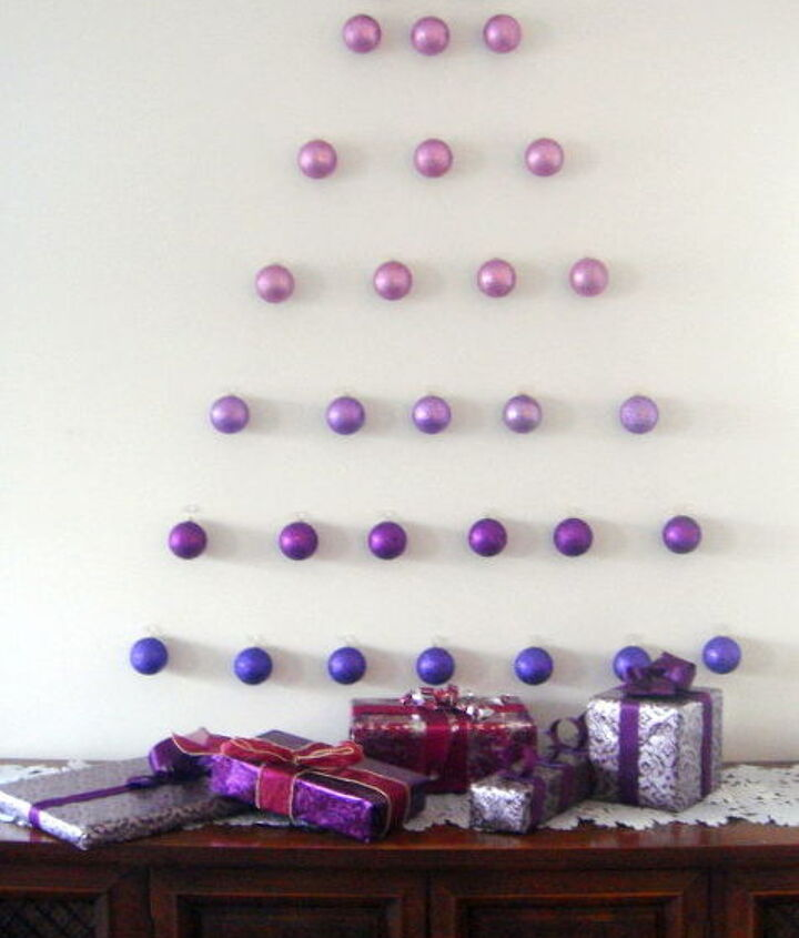 Seven rows of thirty four ornaments in shades of purple makes for a festive holiday look.
