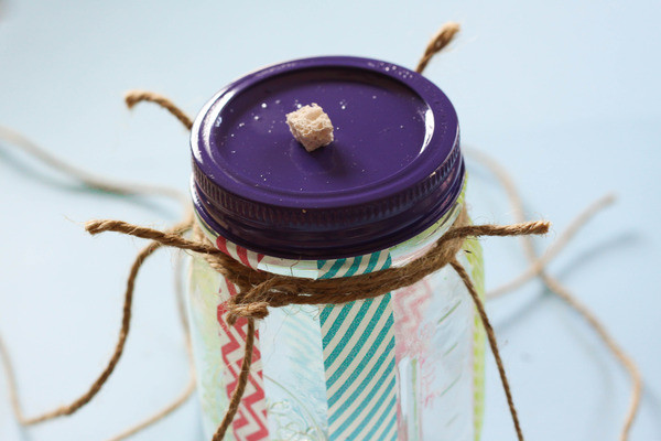 make a diy butterfly feeder in 6 easy steps, crafts, mason jars, 5 Use your string to make a hanger Flip your jar upside down Tie some string around the neck of the jar slightly below the lid Cut two more pieces of string that are about two feet long