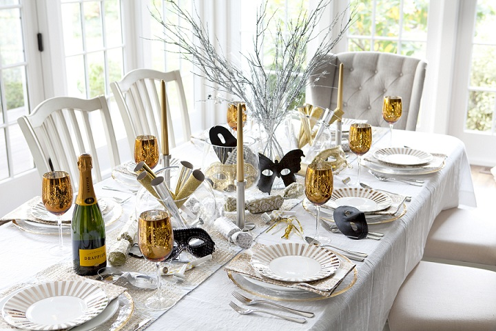 Masquerade: Shimmering with sequins and gleaming with golds. Look no further than the noisemakers, horns, and masks to be used that night as a centerpiece. Set the table by layering metallic-accented linens with gold dishes.