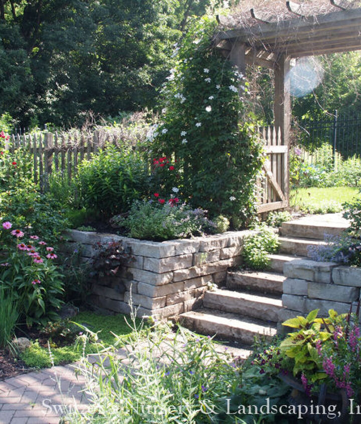 The natural stone step are functional... but with the arbor and gate they become a beautiful focal point of this backyard garden paradise.  Make sure there is enough room at the top and bottom of the steps to linger and enjoy.