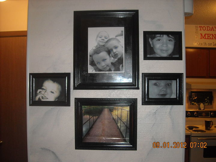 Wall of grand children on the faux marble wall I painted.