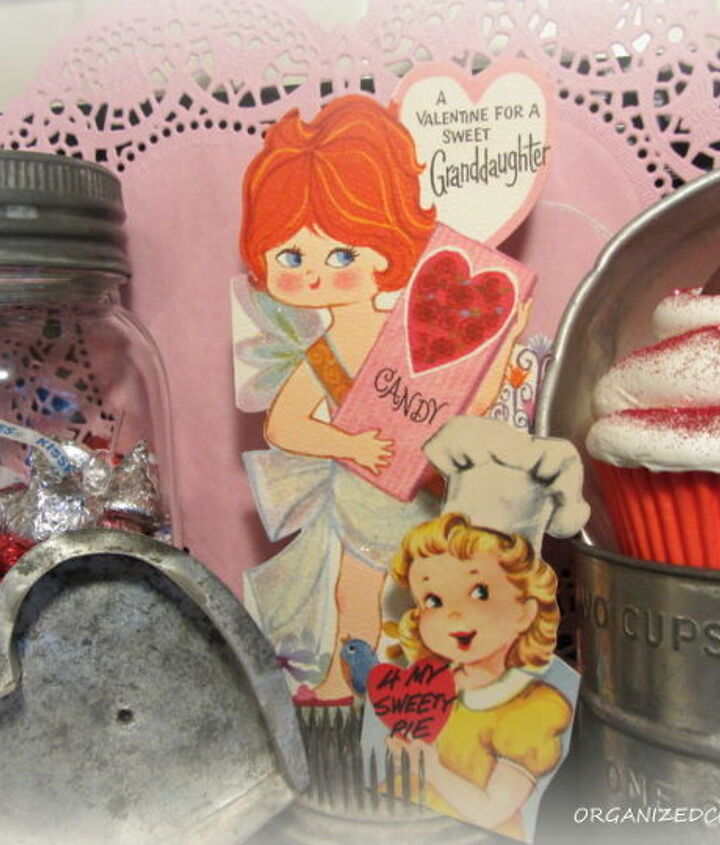 I added more candy, a faux cupcake, more vintage kitchen utensils and a couple of my childhood Valentines to complete the vignette.