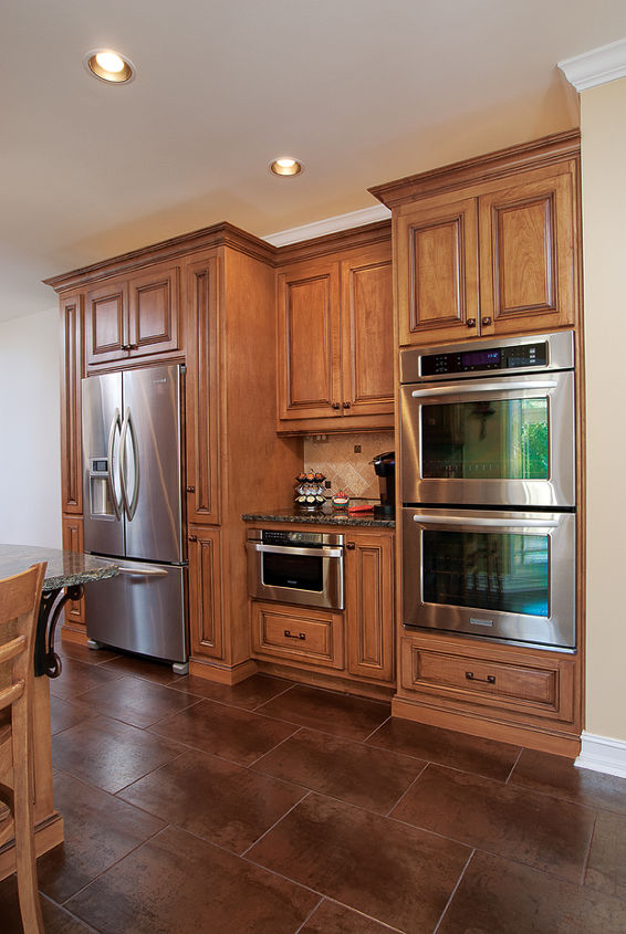 Don't want to invest in a built-in? Construct and design your cabinetry to meet the depth of your free standing refrigerator -- giving the illusion its a built-in!