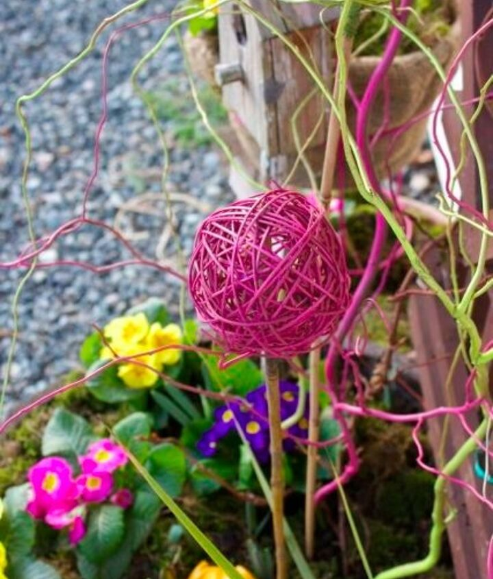 Spray paint wicker balls and curly willow in bright spring colors