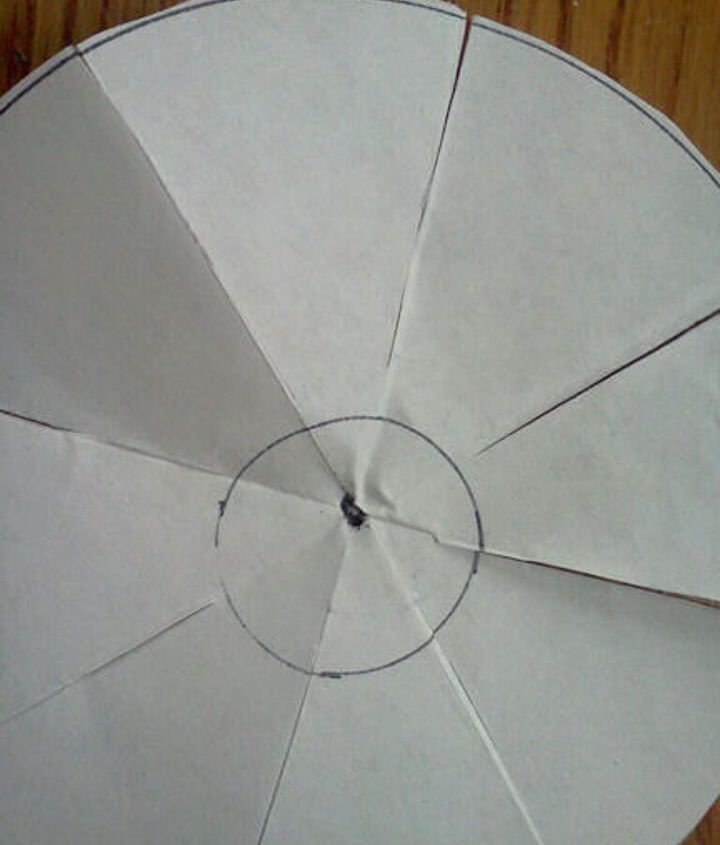 Open the circle up and you will see your cut lines in the folds.  Cut down to the small circle.