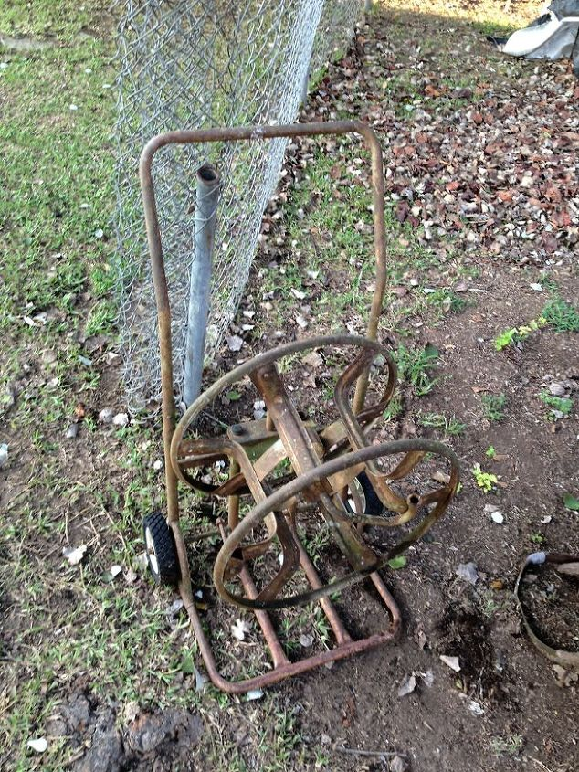 old garden hose reel and a 39 year old wheel barrow, repurposing upcycling