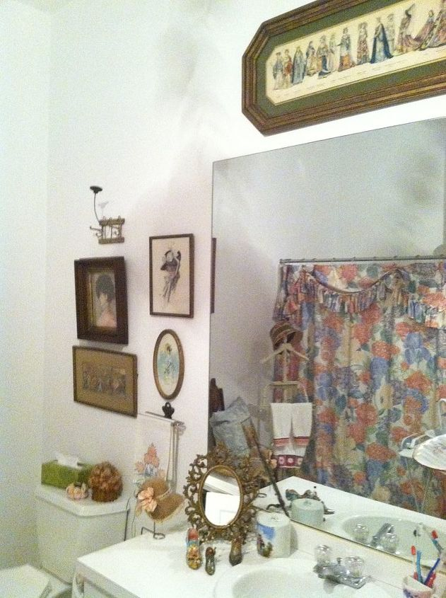 The guest bath. Love the gallery wall of vintage prints.