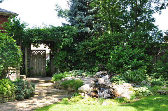 Another option for a small garden is to do a pondless waterfall. See more of this garden here: http://threedogsinagarden.blogspot.ca/2013/08/a-few-ideas-from-griessers-mid-summer.html