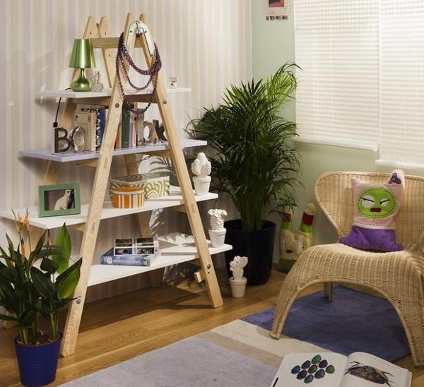 I love this idea of a small ladder. The natural wooden look is preserves and the pearls hanged on the top of the unit add a shabby chick touch.