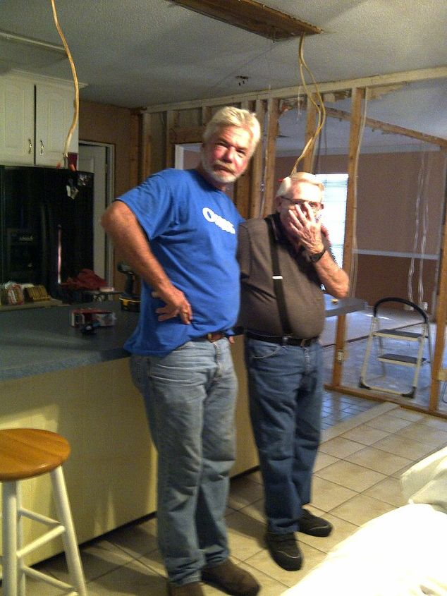 My dad and honey after a long day of demo.  We took down the formal dining and living room walls.