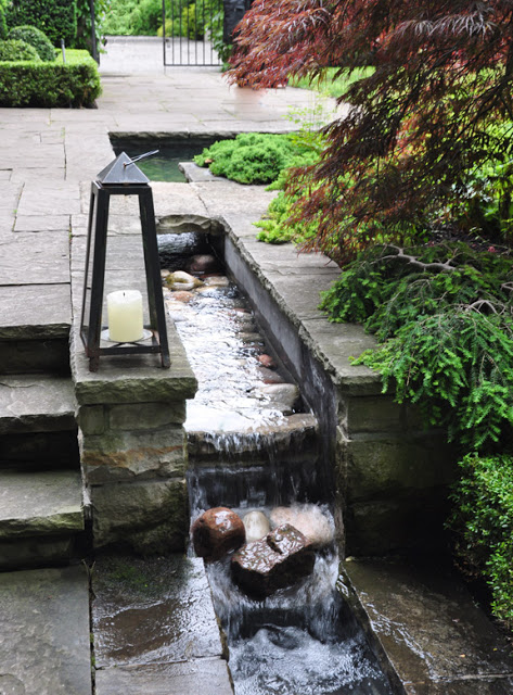 Here is a more contemporary take on a pond. See a few additional Images here: http://threedogsinagarden.blogspot.ca/2013/01/pin-ideas-small-water-features-garden.html