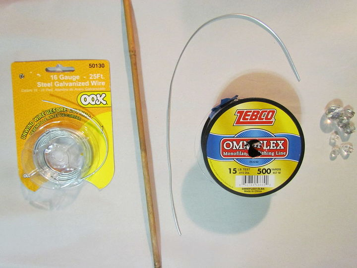Simple supplies, and simple to do.  16 gauge steel wire. I used a thicker wire to hold bend,  small bamboo stick, but large enough for the wire to stick inside. The monofilament fishing line to make the tassels.