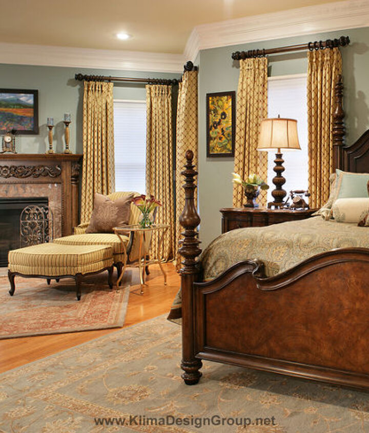 Master bedroom in Teal and Gold with gold drapes and art work in purple, gold, deep blue and rust