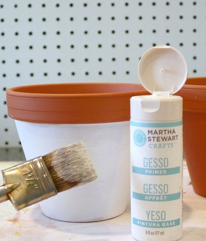 Using a dry paintbrush, lightly brush white gesso around the outside of the pot, below the rim. Brush lightly and add layers, letting each layer dry in between.