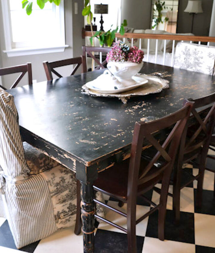 Imperfect perfection - a distressed black kitchen table is a true sign of warmth and casual. Coffee anyone? (her coffee was good too!)
