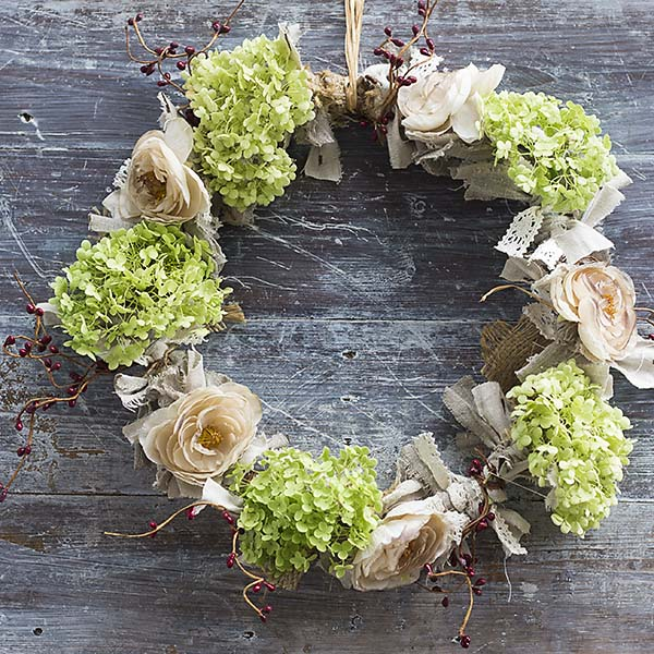 A Fall wreath in neutral colors that will last a long time.