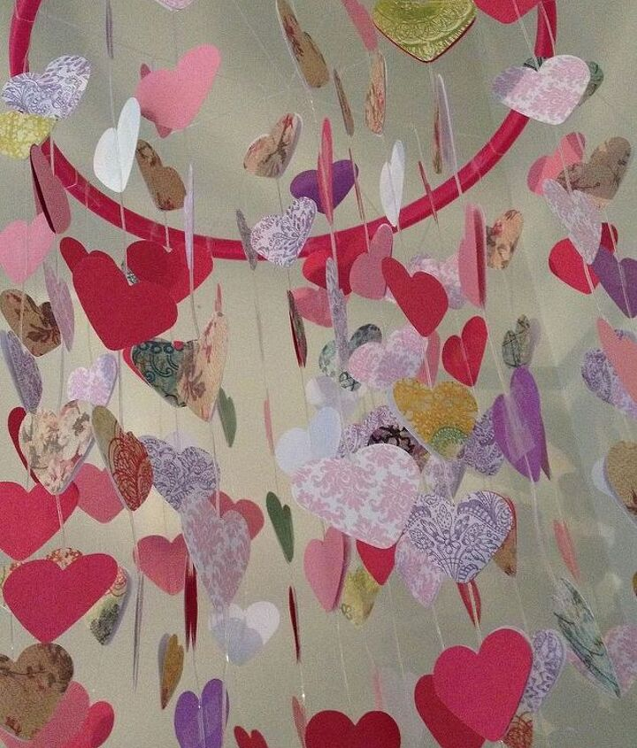 diy valentine s mobile hanging hearts, crafts, seasonal holiday decor, valentines day ideas, Close up view of the patterns and colors I used scrapbook paper and a heart punch