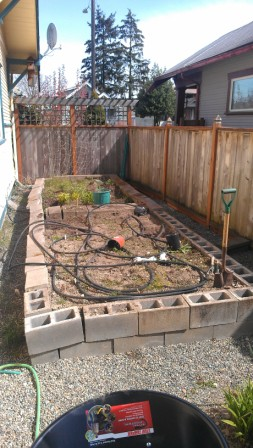 reuseing cinder blocks to make a fire pit, decks, gardening, outdoor living, This is what our Garden looked like before we removed the blocks falling apart now what do we do with them