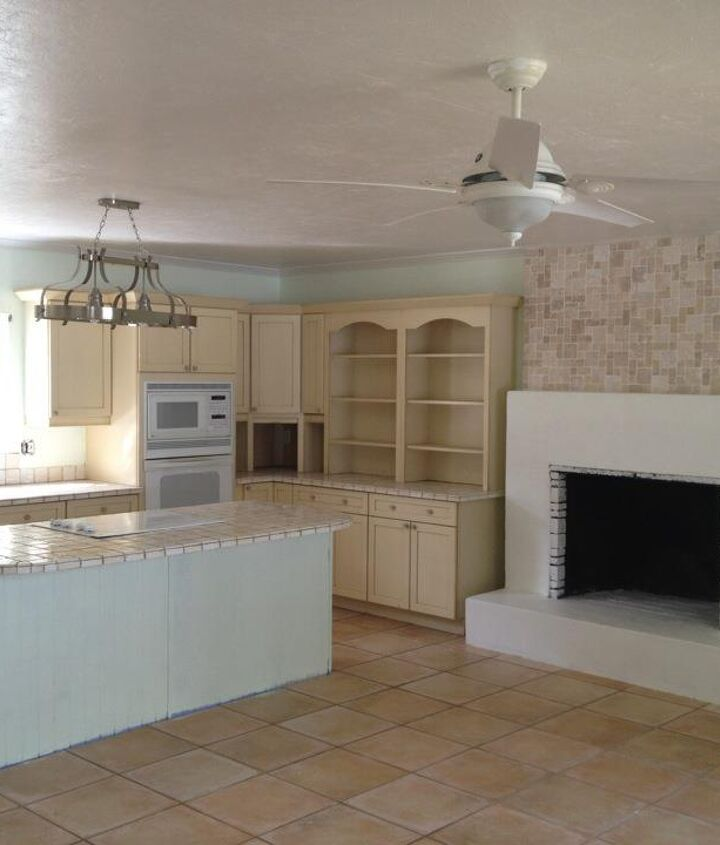 """After (we live in Florida, so I chose a happy color to help brighten the room & tiled the top portion of the fireplace) ..we have plans to continue renovating, but our immediate concern is the large """"hole"""" in the room :)"""