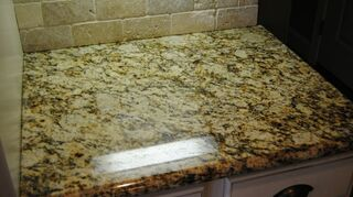 , light stone sealed with permanent sealer with 100 transferrable lifetime warranty against staining and etching