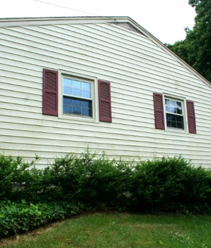 Vinyl side of the house with maroon shutters.