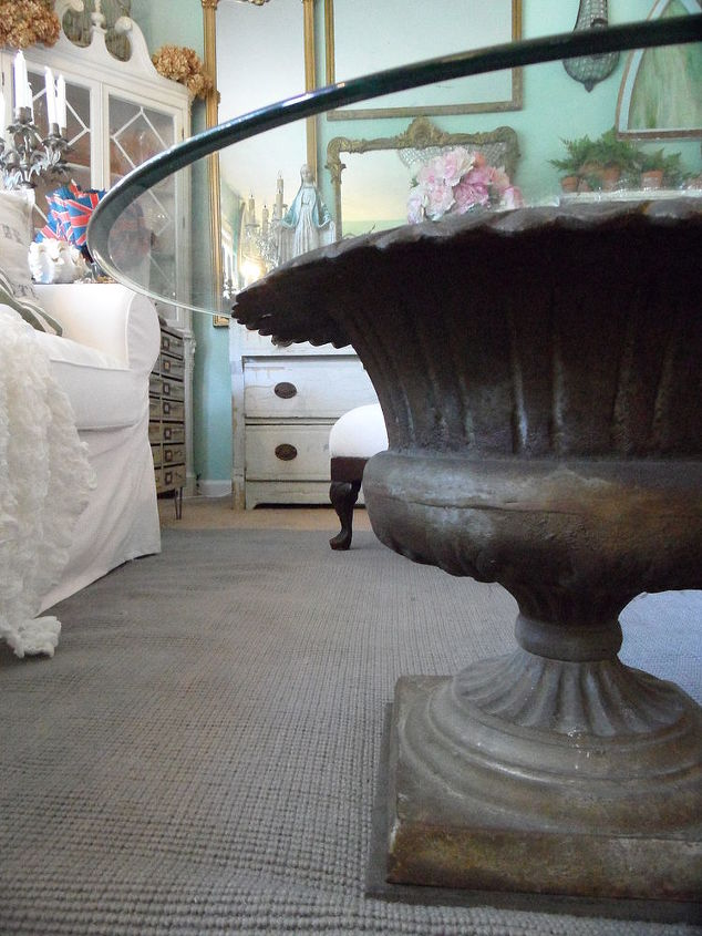 The urn is about two feet across at the widest point. The glass is three feet at the widest point.