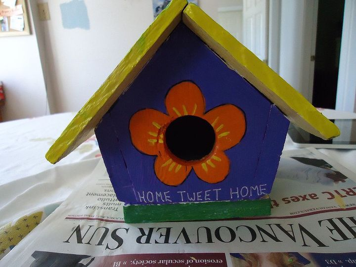 Okay my writing isn't quite centered but it doesn't really matter. I clear coated the bird house this morning. Now to mount it somehow. Most likely on a post.