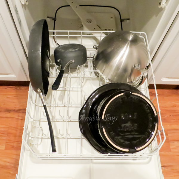 Wash large dishes in their own load instead of a mixed load. This way the pots have enough space and so they don't take up too much space in a regular load. (Some pots and pans are not dishwasher safe.)