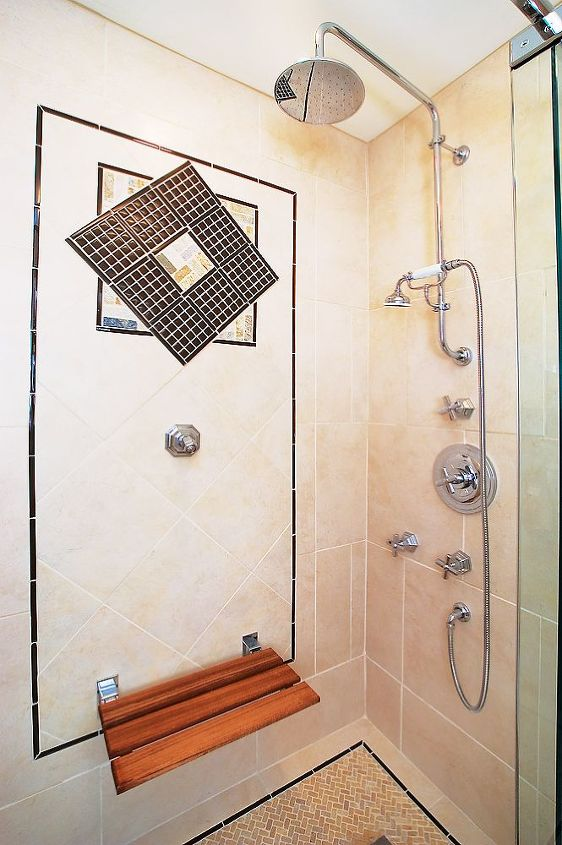 The interior of the shower with Teak shower bench down