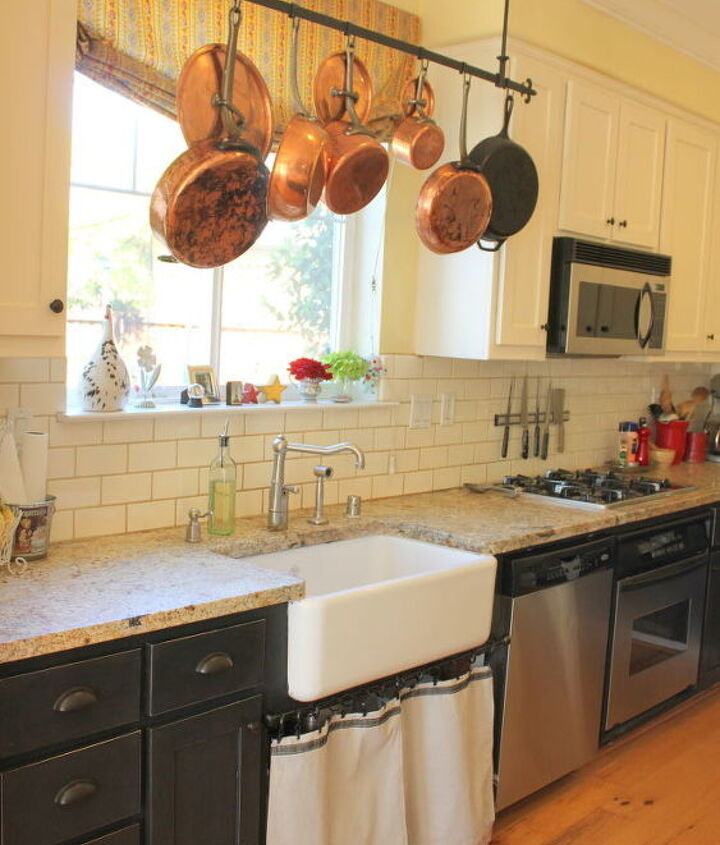 Farm Style sink and Copper Pots hanging above give my kitchen a truly rustic feel.