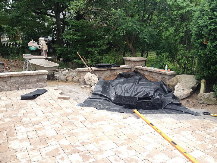 Once the Paver Patio, Wall and Pillars were in place, It was time to build the new Waterfall Water Feature for this residence in Brighton NY by Acorn Landscaping of Rochester NY Basin is dug out with Aqua-Blocks seen here