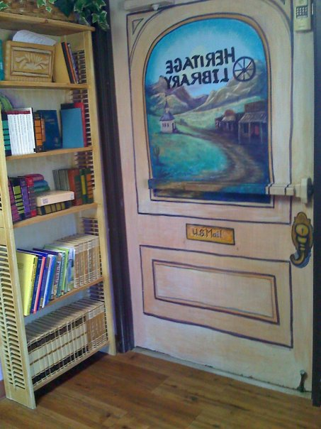 I built library book shelves with old window shutters.