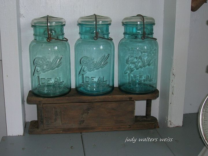 Ball jars on top of an old dynamite box