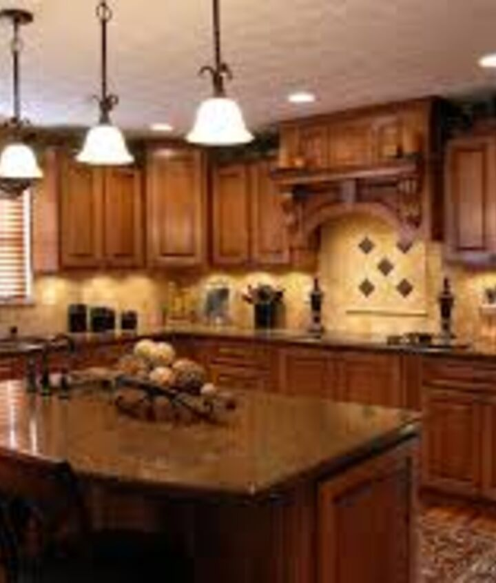 I love this kitchen! The window over the sink, The island,and the lighting used.