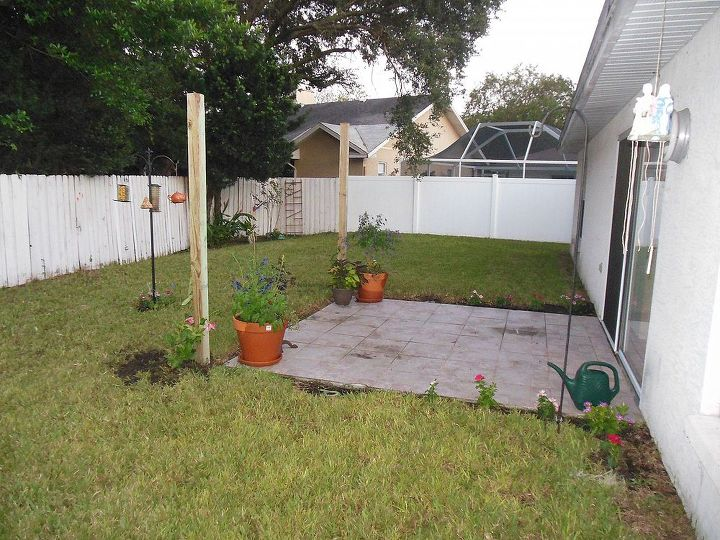 Planted the flower pots, dug two holes and mixed the concrete for the two arbor columns that will be covered in vines and will  support the shade fabric.  Waiting for concrete to dry.  9/9/13