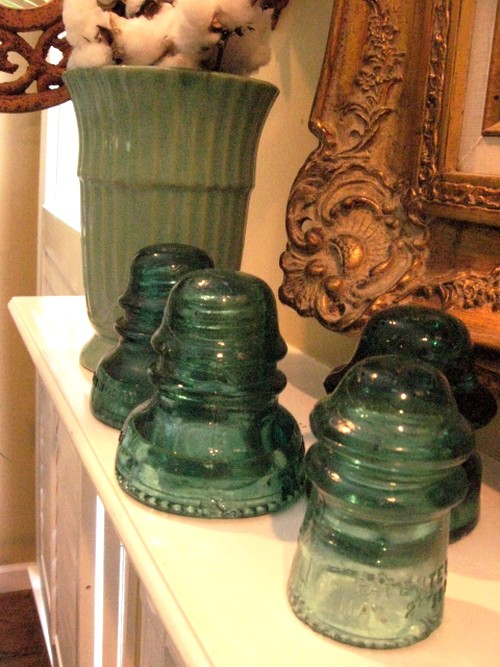 These vintage insulators are yardsale finds too, that's one of my favorite ways to shop thriftily. Love their color and texture.