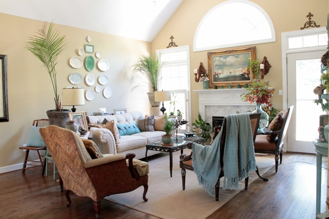 This is my former living room in Birmingham and just by adding a few touches of aqua around the room, it was brought more to life. See the throw on the chair, pillow on the sofa, another pillow on the bamboo chair, a planter on the coffee table, and the aqua accessories on the fireplace mantel