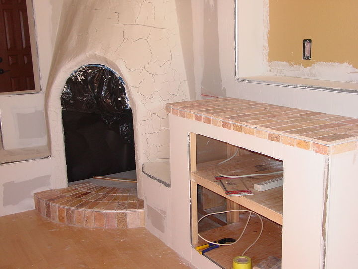 addition of a fireplace and entertainment center in our home in arizona, concrete masonry, doors, fireplaces mantels, living room ideas, woodworking projects
