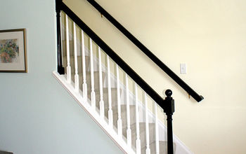 mini makeover paint your banister black, home decor, painting, The contrasting black rail makes a huge difference against the pastel wall colors