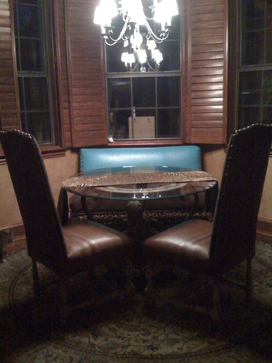 The bench I built after I upholstered it, in place with the owners dining chairs