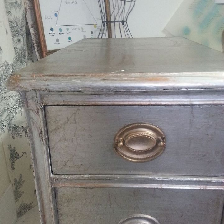 Reynolds Wrap- aluminum foil covered badly damaged piece of furniture. Handles also covered in French gilded wax.