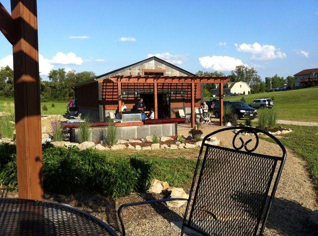 rustic outdoor summer kitchen, concrete masonry, concrete countertops,  outdoor living, patio,