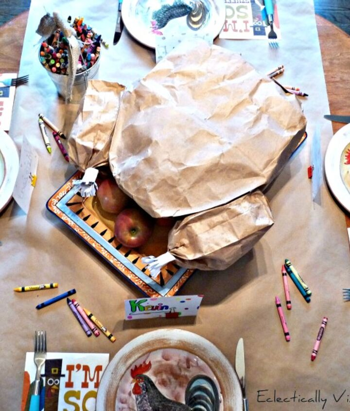"The kids table is the place to be with this simple to make Tom Turkey ""carveable"" centerpiece.   http://eclecticallyvintage.com/2012/10/paper-bag-thanksgiving-turkey-centerpiece/"