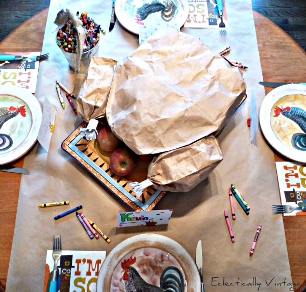 """The kids table is the place to be with this simple to make Tom Turkey """"carveable"""" centerpiece.   http://eclecticallyvintage.com/2012/10/paper-bag-thanksgiving-turkey-centerpiece/"""